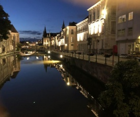 studio medieval city center at river de Leie